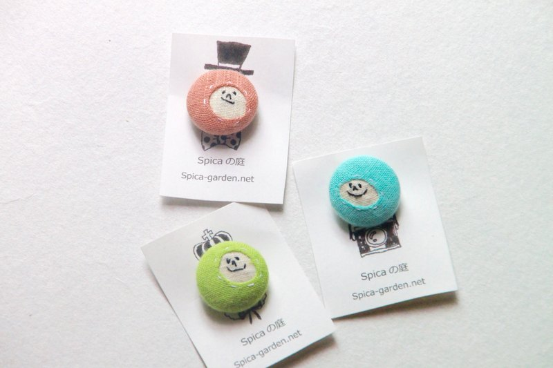Facial embroidery  A brooch  A covered button  In a set of 3 pink/blue/green