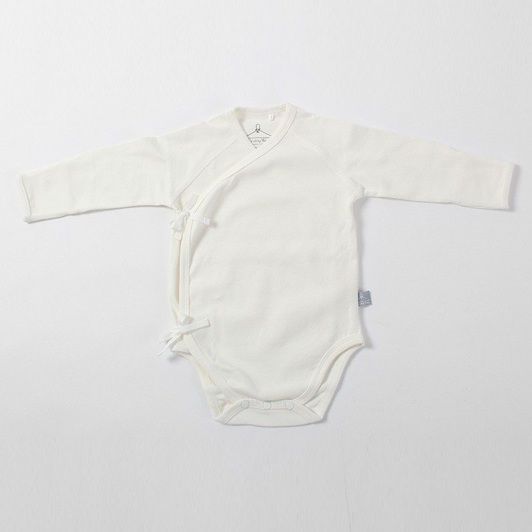 Organic cotton. Pinken newborn child with a piece of clothing - white