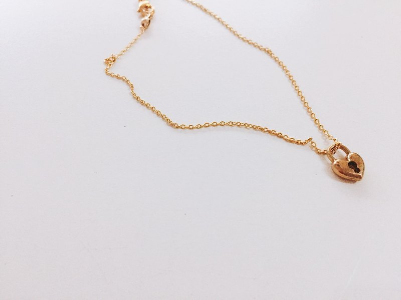 Golden mini heart lock anklet