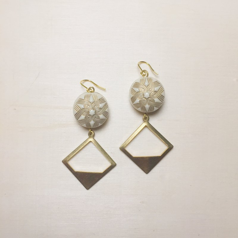 Vintage white carved star diamond earrings