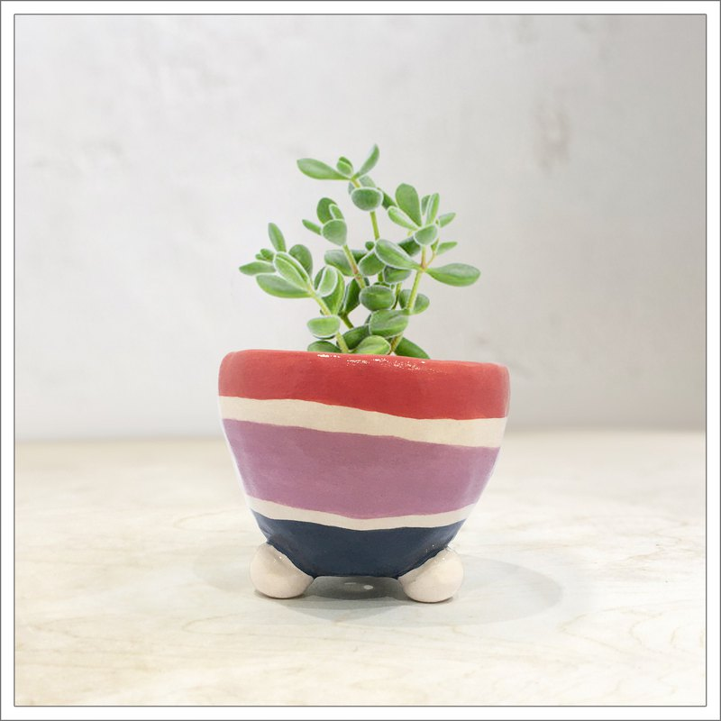 Hand pinched and painted ceramic pot in coral, lilac and indigo straps