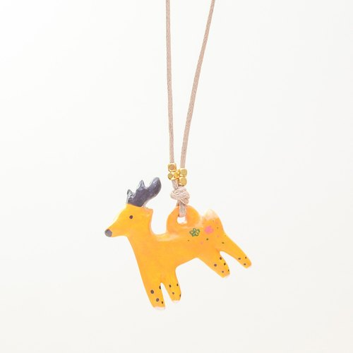 a little yellow Christmas reindeer handmade necklace from Niyome clay.