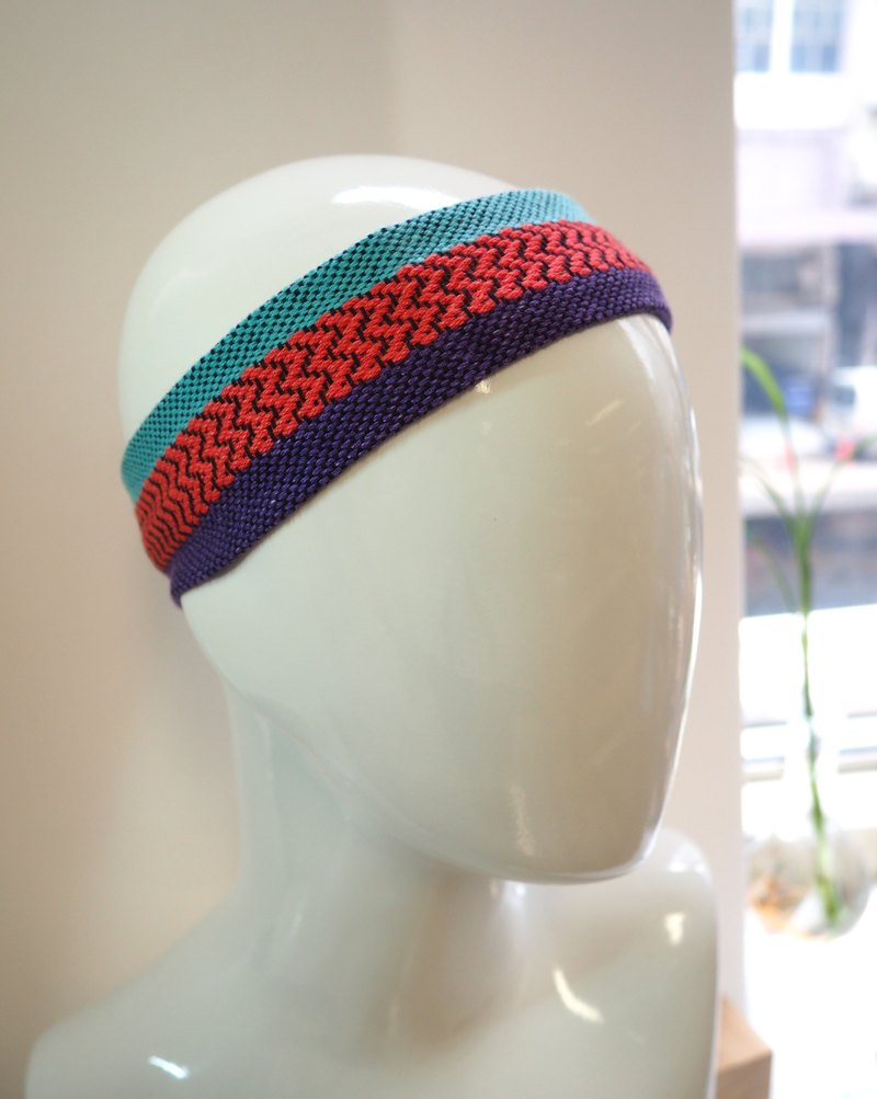 Hand-woven and colored head with purple red and blue