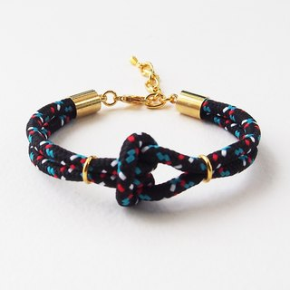 Black mix with blue/white/red knot cord bracelet