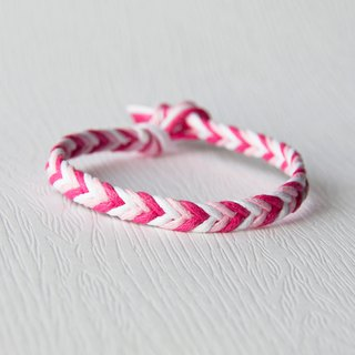 From shallow to deep - fine layer gradient peach / hand-woven bracelet
