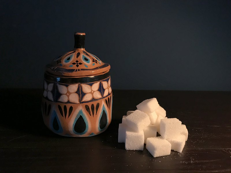 Sugar bowl on the cabinet