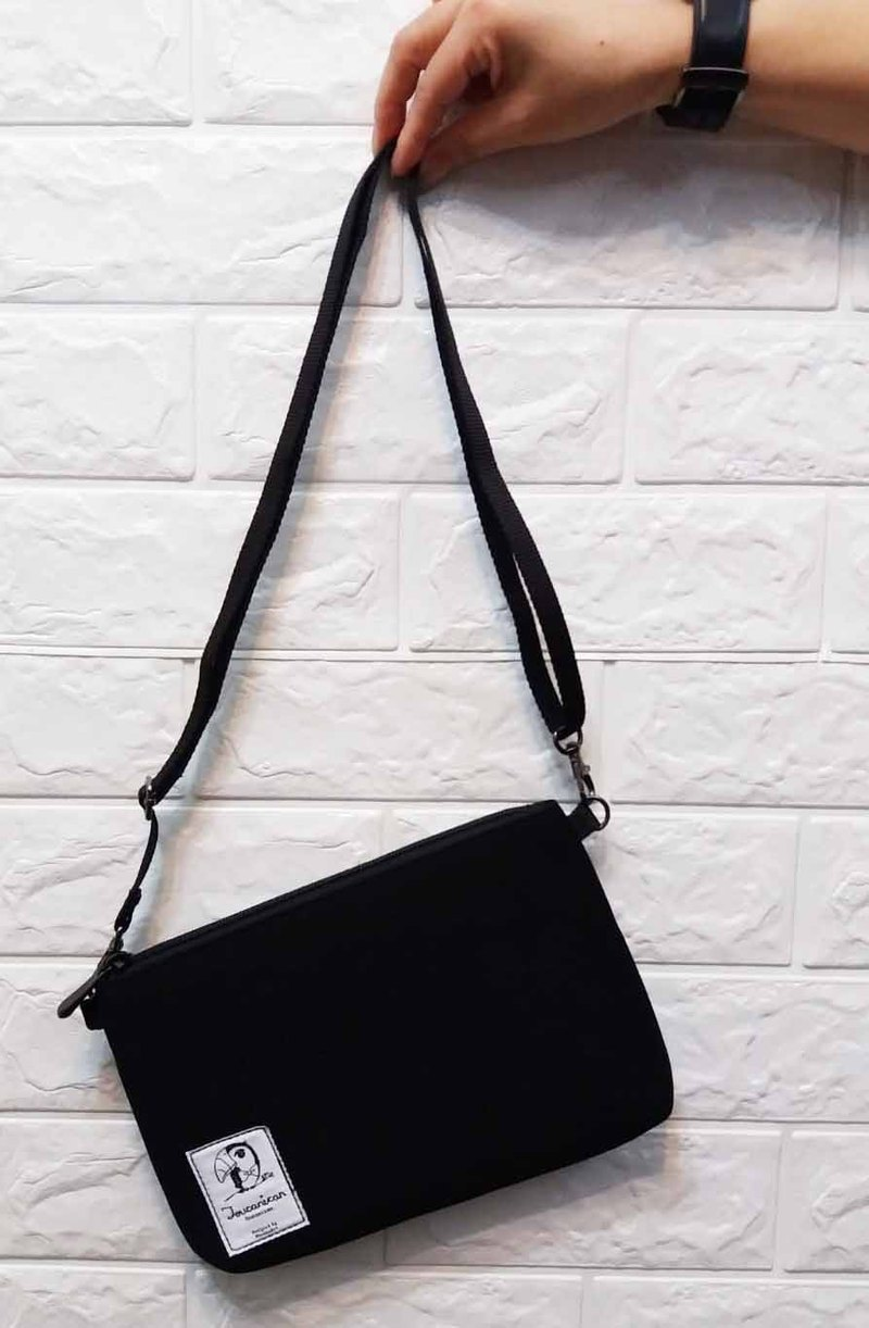 Black neoprene little pouch with detachable crossbody strap
