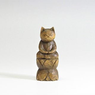 A carving cat, such as the meditation sitting in lotus flower.A1121