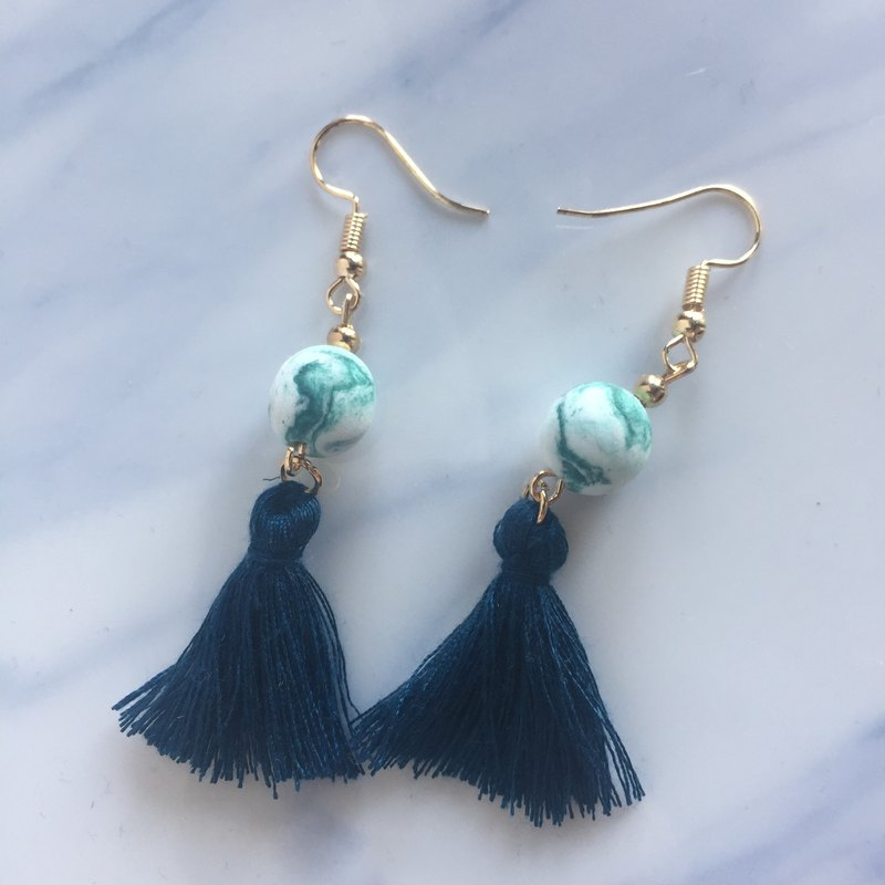 Dark green beads light clay ink earrings