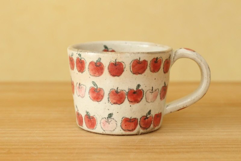 Cup of pink and red apple.
