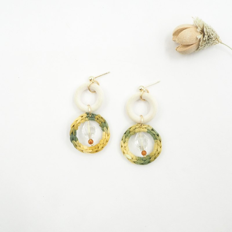 Design section. White crystal orange agate bamboo and rattan woven earrings