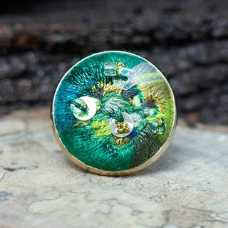 Hand-embroidered ring green light