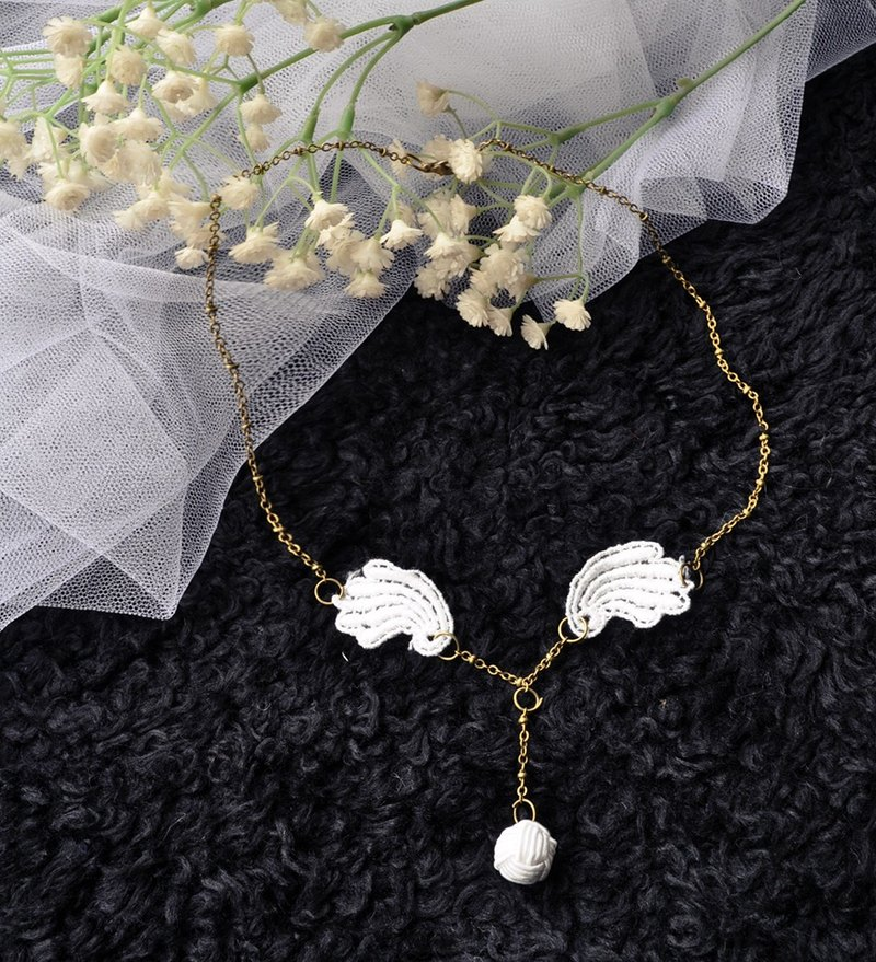 "Christmas gift exchange ""Snow Angels"" models white lace wings necklace white veil and black cloak"