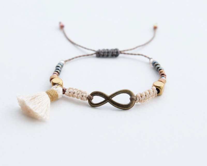 Brass infinity cream with tassel adjustable bracelet
