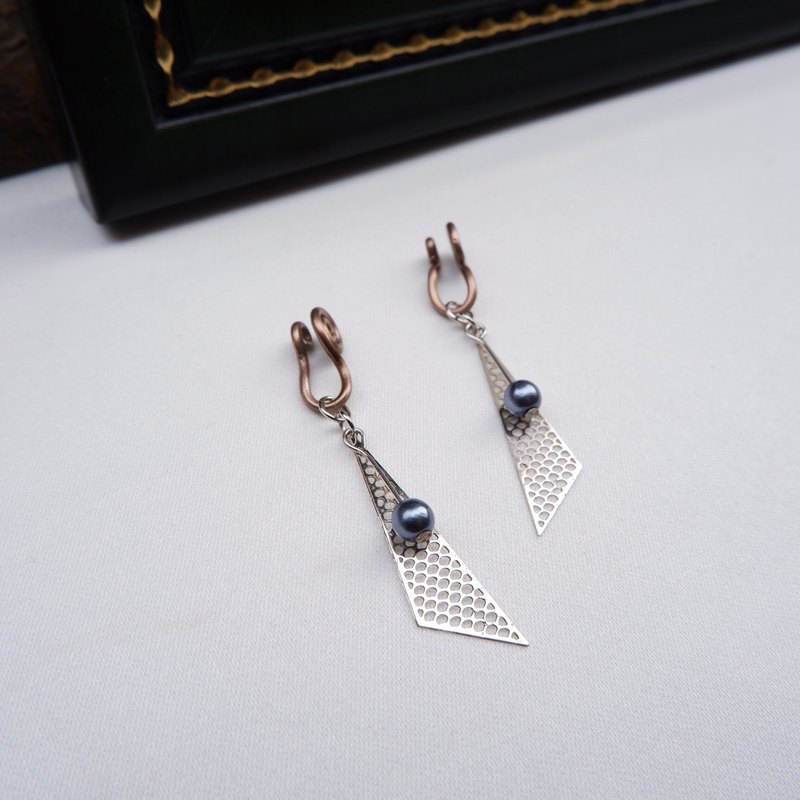 Draped triangle ear clip earrings