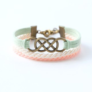 Brass double-infinity in Pale green suede / Cream / Peach