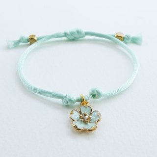 Mint silk rope bracelet with sakura charm