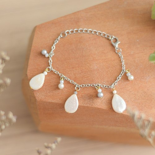 a beautiful handmade real white rain drop pearl bracelet by niyome craft