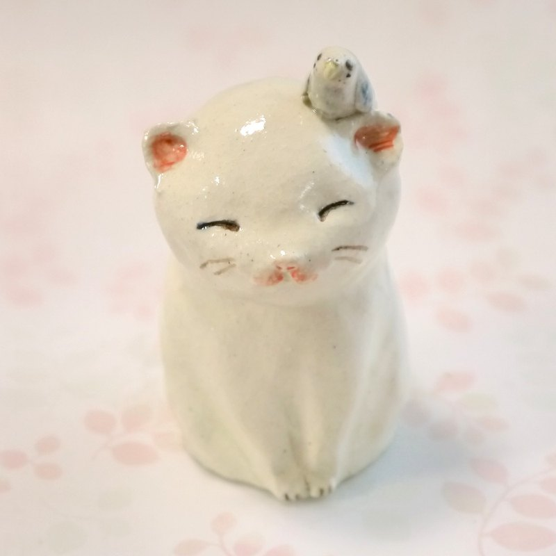One wheel of a pottery of a kitty with a bird
