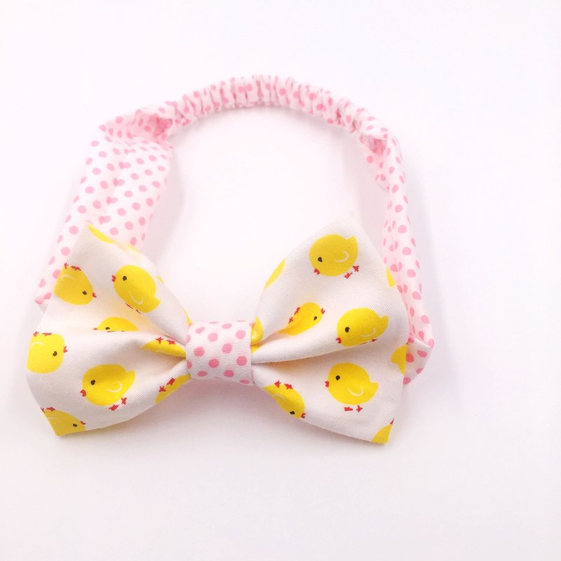 White chick with red stitching bow tie
