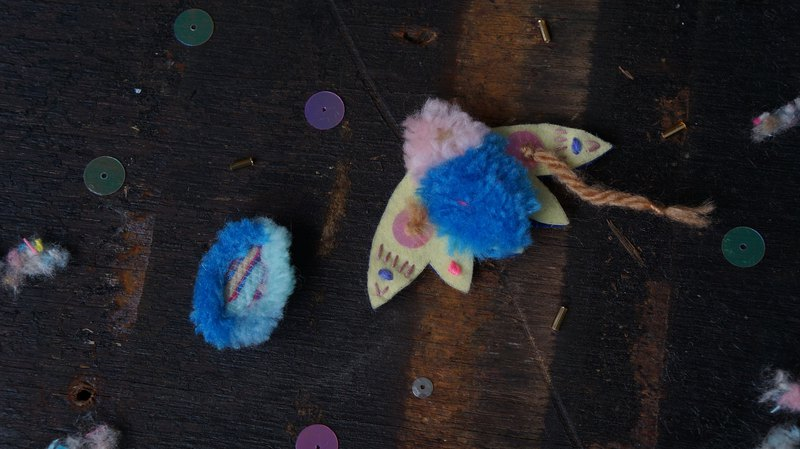 Embroidered blue yellow moth with asymmetrical ear clips