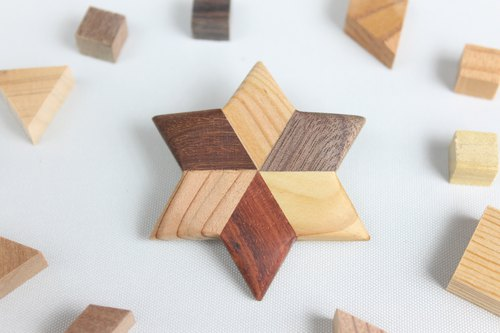 Parquet star shaped brooch