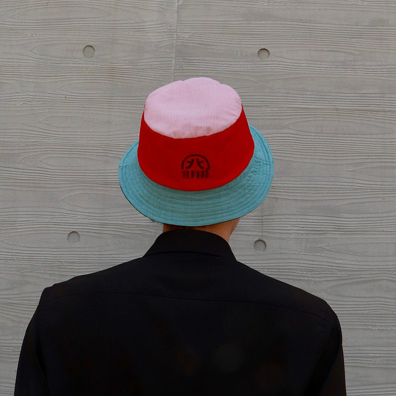 Red with blue reversible bucket hat
