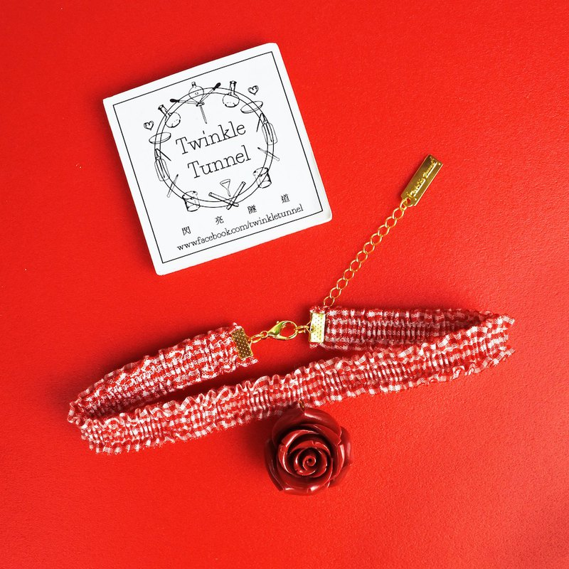 Plaid red rose necklace attached to the necklace