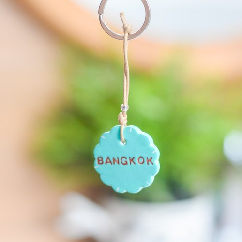 "The soft blue key chain(key ring) with the word "" Bangkok ""."