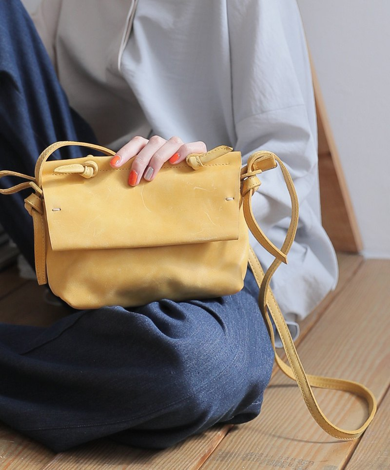 Simple twisted leather small portable shoulder carry bag crayon yellow