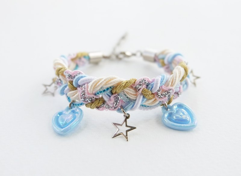 Pastel blue bracelet with heart and star