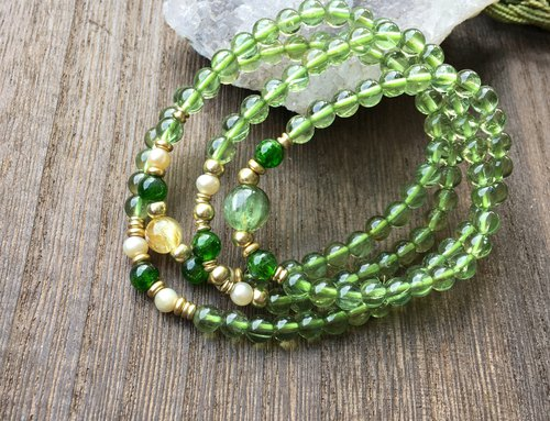 High clarity green apatite four-ring bracelet with chrome diopside, titanium, pearl