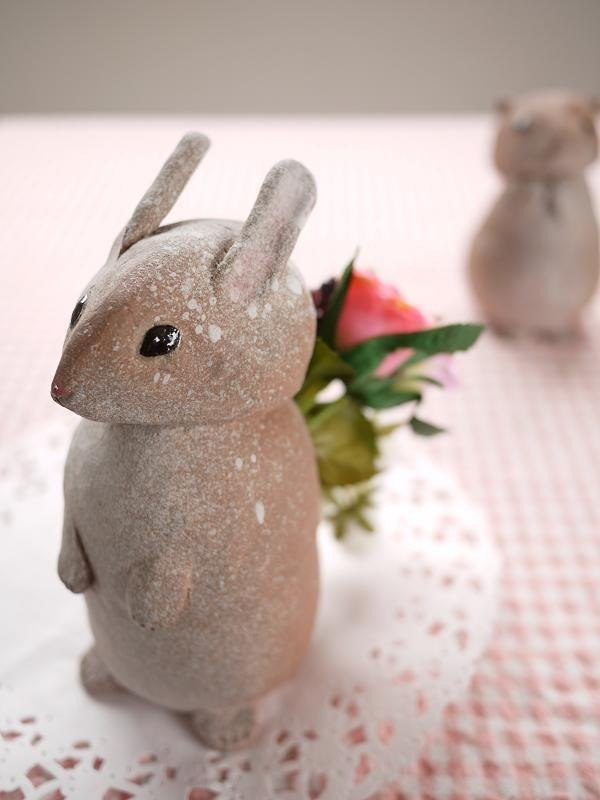 Rabbits carrying flowers