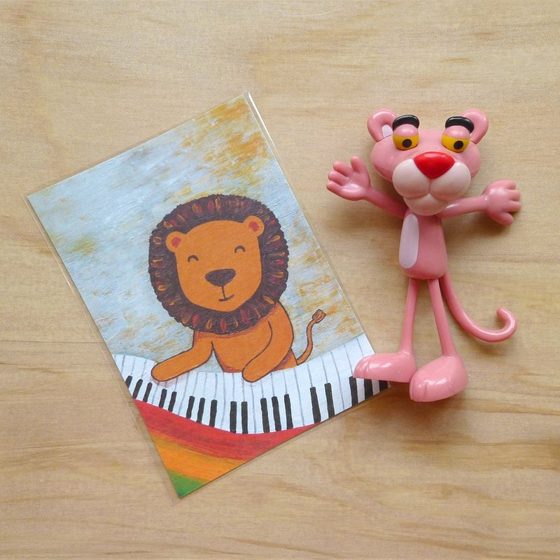 Postcard ∣ lion playing the piano