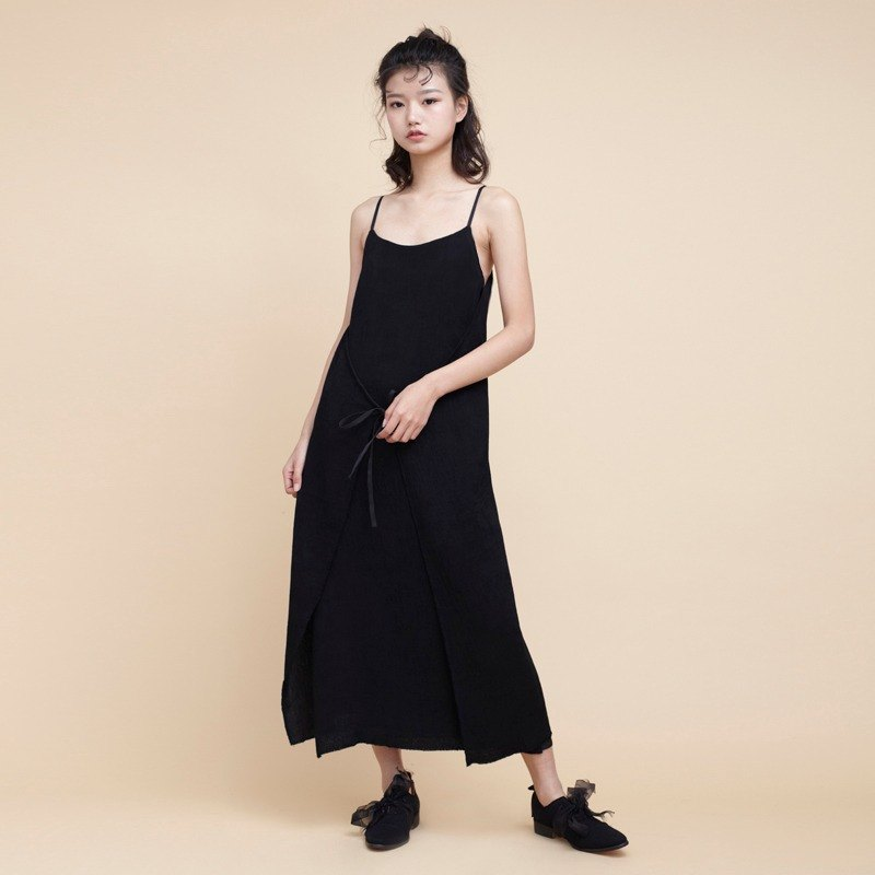 Kitann ino wearing a pleated harness vest dress dress