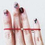 Designer Brands - musubi Red String